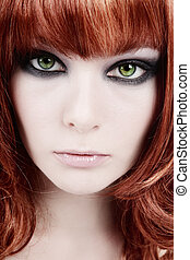 Smoky eyes - Close-up portrait of redhead girl with smoky...