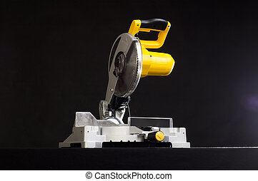 miter saw. - Compound miter power saw isolated on a black...