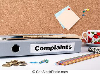Complaints.Folder on office desk. Money, Coffee Mug and...