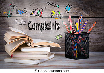 Complaints, Business Concept. Stack of books and pencils on...