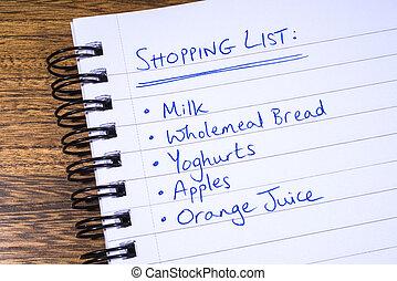 Shopping List - A shopping list written in a notepad.
