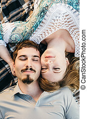 Directly above shot of young couple lying in a park