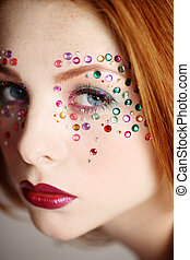 Fancy makeup - Close-up portrait of beautiful redhead girl...