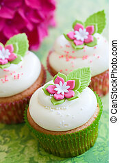 Flower cupcakes - Cupcakes decorated with pink and white...