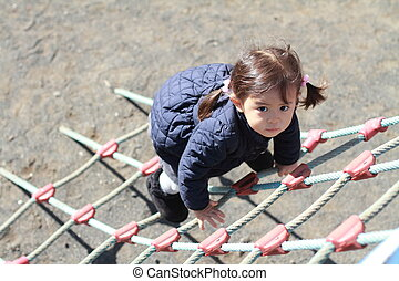 Japanese girl playing at field athletic (2 years old)