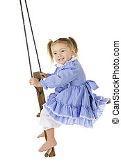 Up in an Old Swing - An adorable preschooler in an old-timey...