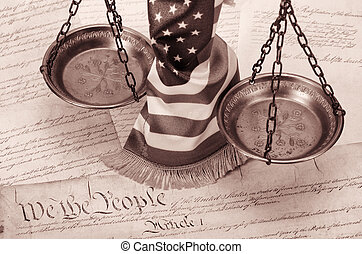 Scales of justice , American flag and US Constitution