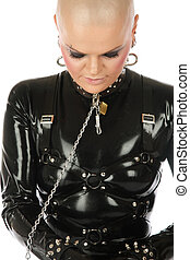 Slave - Skinhead woman in black latex catsuit and collar...