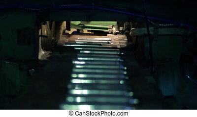 Shooting inside cylinders being delivered to conveyor belt...