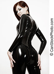 Sexy girl in latex - Black and white colored shot of sexy...