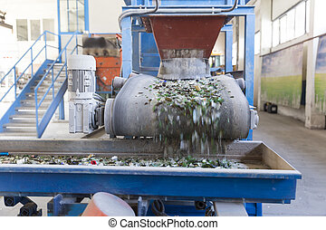 Glass waste in recycling facility. Glass particles - Glass...