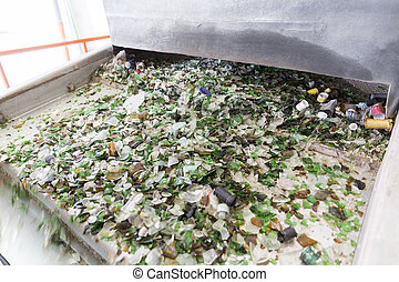 Glass waste in recycling facility. Glass particles in a...