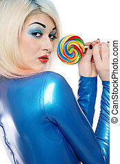Sweet latex - Sexy blond girl in blue latex clothes holding...