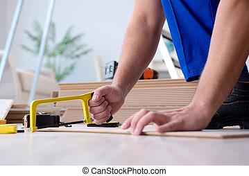 May laying laminate flooring at home