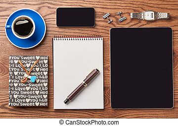 Tablet, coffee and notepad. Paper bag and smartphone....
