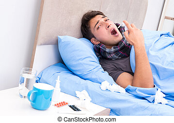 Sick man with flu lying in the bed