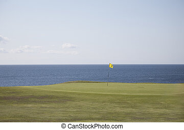Golf Course on the Isle of Arran; Scotland at Blackwaterfoot with the Sea in the background