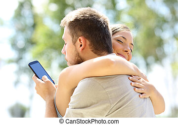 Cheater hugging his innocent girlfriend - Cheater texting...