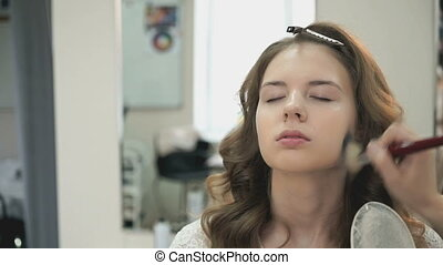 Make up for beautiful bride at the beauty salon