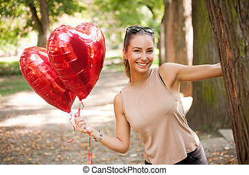 My summer hearts - Beautiful cheerful young brunette woman...