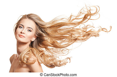 Blond beauty with amazing hair. - Portrait of a young blond...
