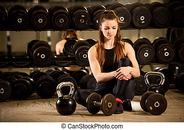 Woman workout in fitness gym with barbells - powerlift...