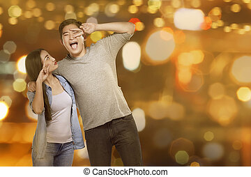 Young asian couple with funny expression