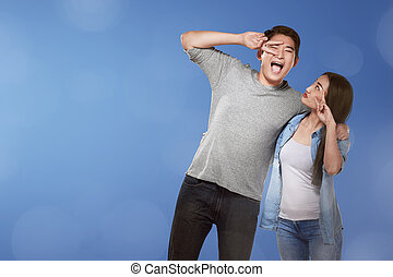 Romantic asian couple with funny expression