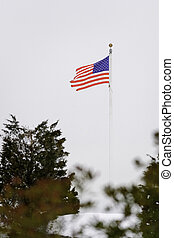 Worn American flag in stiff breeze - Stiff breezes along...