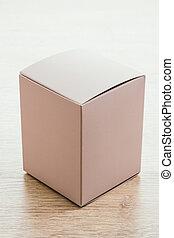 Mock up paper box on wooden background - Vintage light...