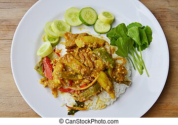 stir fried wild boar with red curry on rice
