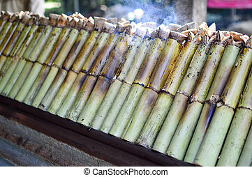 Glutinous rice roasted in bamboo joint, Thai dessert