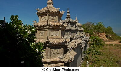 Wall with Small Stone Pagodas by Buddhist Temple Blue Sky -...