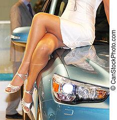 girl on the car hood