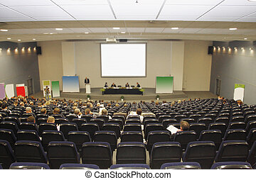 conference hall - Buisnessmen works at a conference in big...