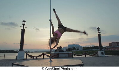 Street Pole dance on sunset stock footage video - Street...