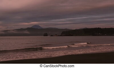 Sunset over Pacific Ocean in the Bay Zavoiko stock footage...