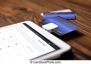 Payment with a Credit Card Chip Reader on a Tablet - Credit...
