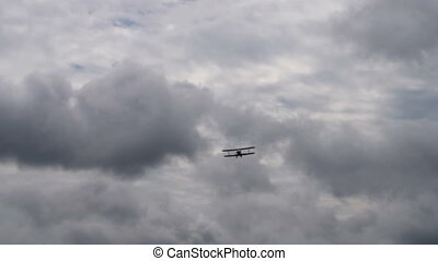 Retro plane flying in cloudy sky - Old plane flying in dull...