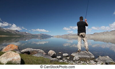 Fisherman with spinning catching fi - Khoton Nuur lake...