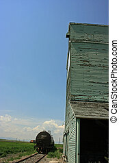 Grain Elevator - Grain elevator and box car in Alberta,...