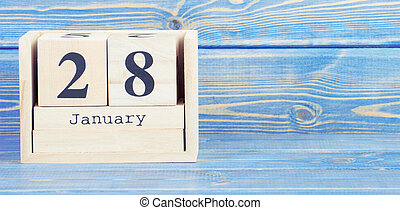 Vintage photo, January 28th. Date of 28 January on wooden cube calendar
