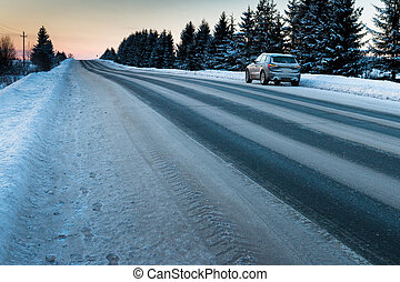 Snow-covered road on a winter day