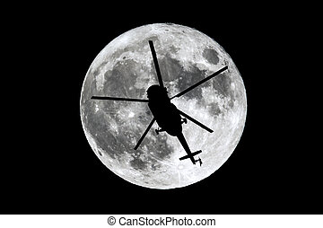 Full Moon helicopter silhouette