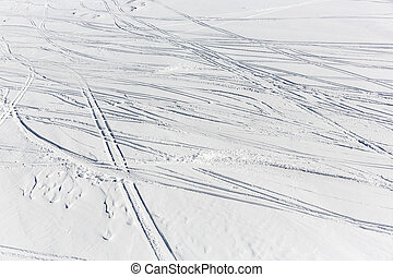 Ski slope remains traces prints track - Traces of skiers are...