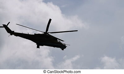 Two military helicopters flying. Black silhouettes in the...