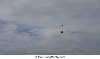 Fighter plane in cloudy sky - Fighter jet flying in cloudy...