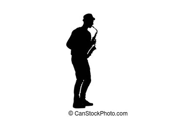 Jazz melodies performed by young musician. Silhouette on...