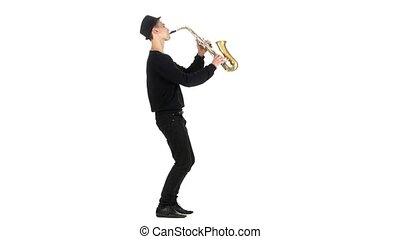 Young saxophonist plays a musical instrument. White studio -...
