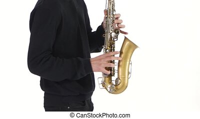 Solo saxophone. Playing young musician man in a white studio